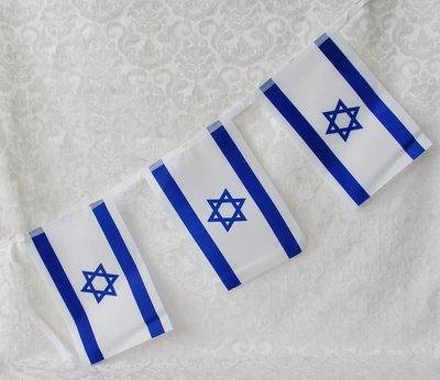 Slinger met 6 Israel vlaggetjes van stof. Totale lengte ongeveer 1.5 meter