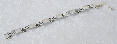 Armband, zilver en uit de collectie van de Israëlische ontwerper Tamir Zuman met mooie handbewerkte schakels.
