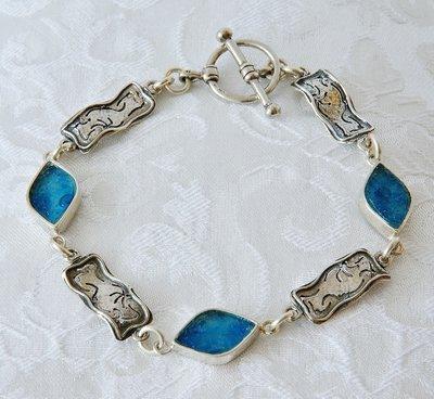 Armband, met rechthoekig bewerkt zilveren en ruitvormige Romeins glas schakels